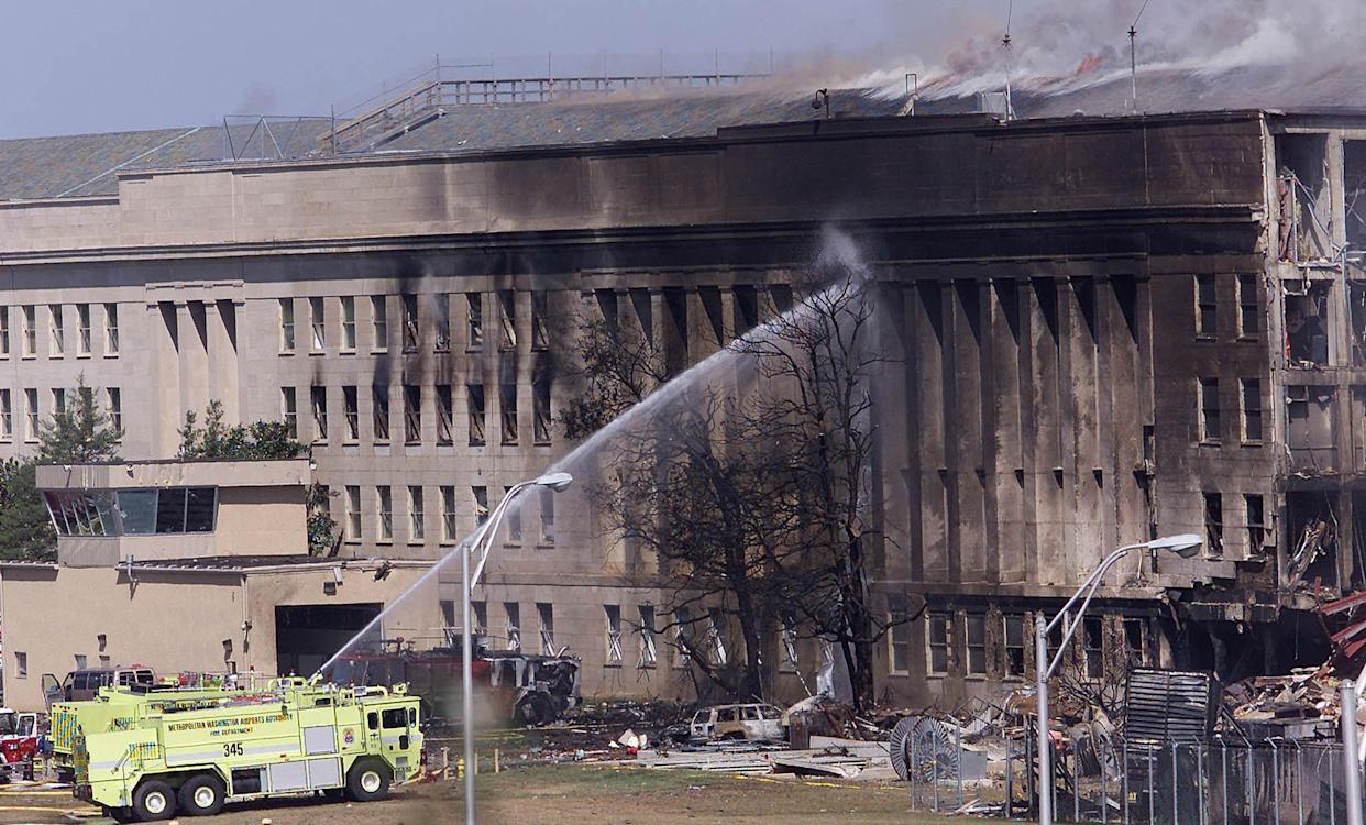 (FILES) In this file photo taken on September 10, 2001, an emergency vehicle fights a fire at the Pentagon in Washington, DC, hours after a hijacked airplane crashed into the Pentagon.     The remains of two more victims of 9/11 have been identified, thanks to advanced DNA technology, New York officials announced on September 8, 2021, just days before the 20th anniversary of the attacks. The office of the city's chief medical examiner said it had formally identified the 1,646th and 1,647th victim of the al-Qaeda attacks on New York's Twin Towers which killed 2,753 people. They are the first identifications of victims from the collapse of the World Trade Center since October 2019. / AFP / STEPHEN JAFFE