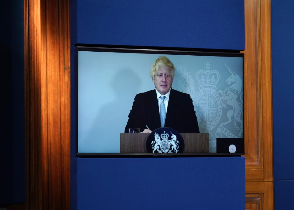 LONDON, ENGLAND - JULY 19: Britain's Prime Minister, Boris Johnson attends a media briefing on coronavirus online via a screen from Chequers, the country house of the Prime Minister where he is self-isolating at Downing Street on July 19, 2021 in London, England. The Prime Minister and Chancellor were both contacted by Track and Trace this weekend after the Health Minister, Sajod Javid, tested positive for the Covid-19 virus. Today sees the complete relaxation of Covid lockdown rules and is being dubbed