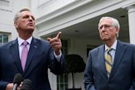 US House Minority Leader Kevin McCarthy (left) has sought to smooth over differences among Republicans, saying no one in his party questions the legitimacy of the 2020 presidential election