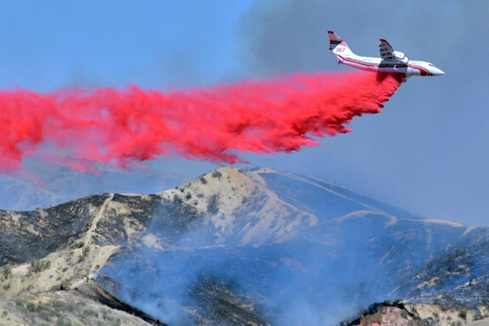 <p>More droughts and heatwaves have increased likelihood of wild fires across the US</p> (AP)