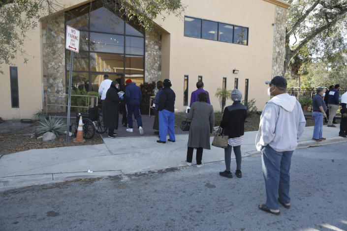 Residents wait in line to receive the COVID-19 vaccine at St. Johns Missionary Baptist Church on January 10, 2021 in Tampa, Florida. (Octavio Jones/Getty Images)