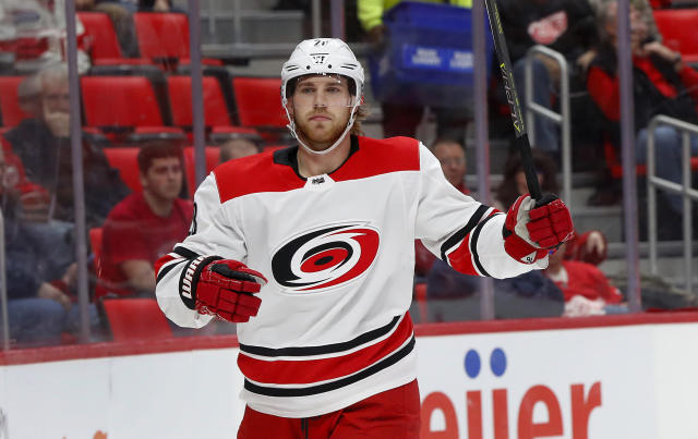 FILE - In this Jan. 20, 2018 file photo Carolina Hurricanes center Elias Lindholm celebrates his goal against the Detroit Red Wings in the first period of an NHL hockey game in Detroit. The Hurricanes have acquired defenseman Dougie Hamilton as part of a blockbuster trade with the Calgary Flames at the NHL draft. Carolina got Hamilton, winger Micheal Ferland and prospect Adam Fox from Calgary for Lindholm and defenseman Noah Hanifin. (AP Photo/Paul Sancya, file)