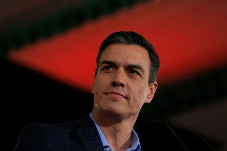 Spain's Socialist leader and current PM Pedro Sanchez looks on as he delivers his speech during a PSOE party meeting before he kicks off his political campaign ahead of the April 28 general election in Dos Hermanas