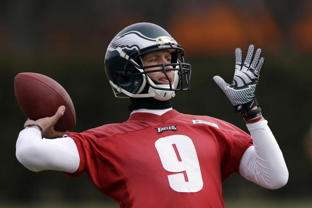 Philadelphia Eagles quarterback Nick Foles throws a pass during NFL football practice at the team's training facility, Wednesday, Jan. 1, 2014, in Philadelphia. The Eagles host the New Orleans Saints in a wild-card playoff game on Saturday. (AP Photo/Matt Rourke)