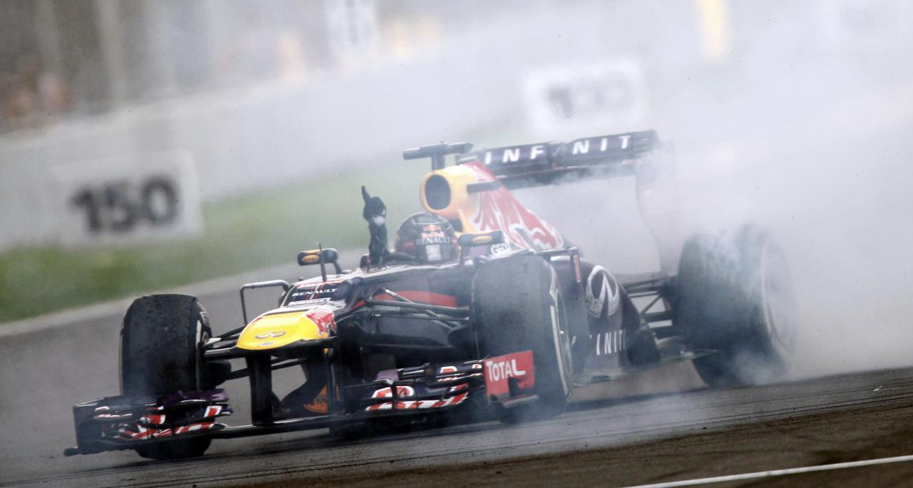 Red Bull Formula One driver Sebastian Vettel of Germany does a burnout to celebrate winning the Indian F1 Grand Prix at the Buddh International Circuit in Greater Noida, on the outskirts of New Delhi, October 27, 2013. Vettel became Formula One's youngest four-times world champion on Sunday after winning the Indian Grand Prix for Red Bull. REUTERS/Anindito Mukherjee (INDIA - Tags: SPORT MOTORSPORT F1)