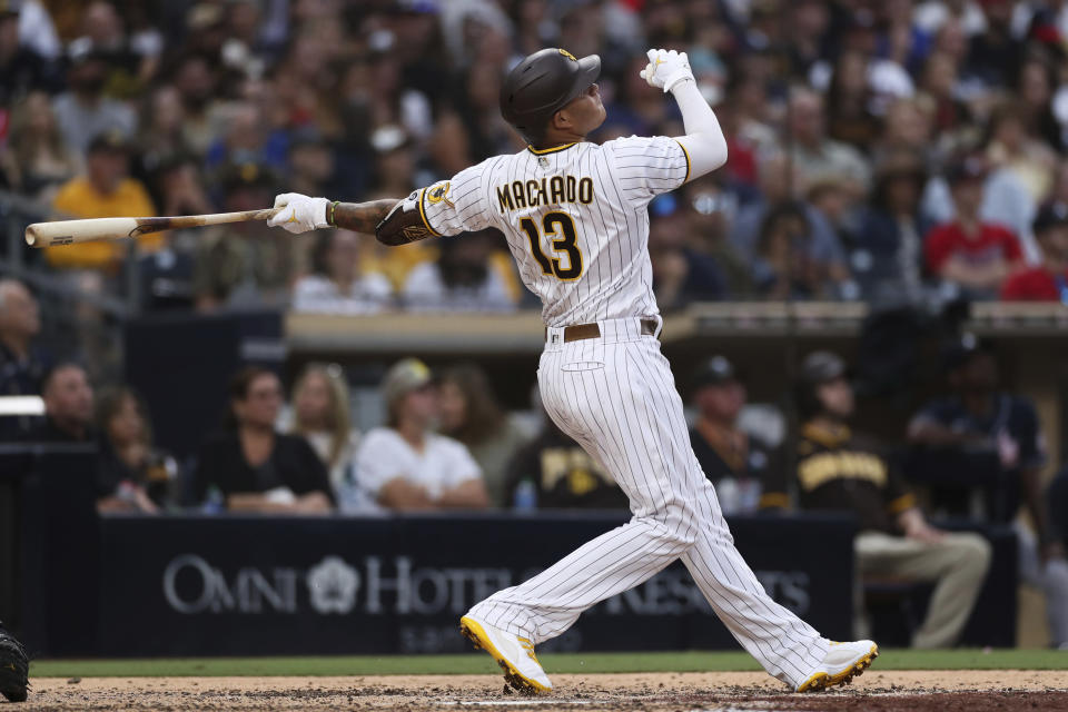 San Diego Padres' Manny Machado watches his grand slam against the Atlanta Braves in the fifth inning of a baseball game Saturday, Sept. 25, 2021, in San Diego. (AP Photo/Derrick Tuskan)