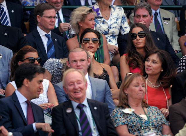 Royal box with Victoria Beckham and Tana Ramsey (centre), Wayne Rooney (second row) and Rod Laver and Ed Miliband (front row) on day thirteen of the Wimbledon Championships at The All England Lawn Tennis and Croquet Club, Wimbledon.