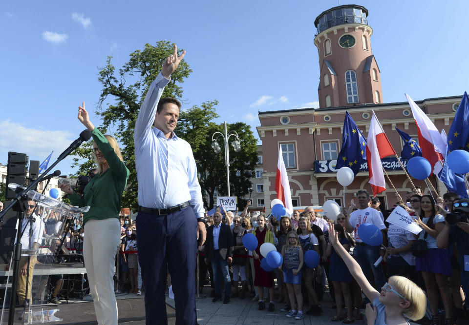 A candidate in Poland's July 12 presidential election runoff, Warsaw Mayor Rafał Trzaskowski with wife Małgorzata celebrate during a rally presidential election runoff, in Częstochowa, Poland, Saturday, July 4, 2020. Surveys give almost equal chances in the vote to Trzaskowski and to incumbent president, Andrzej Duda, who is seeking reelection.(AP Photo/Czarek Sokolowski)