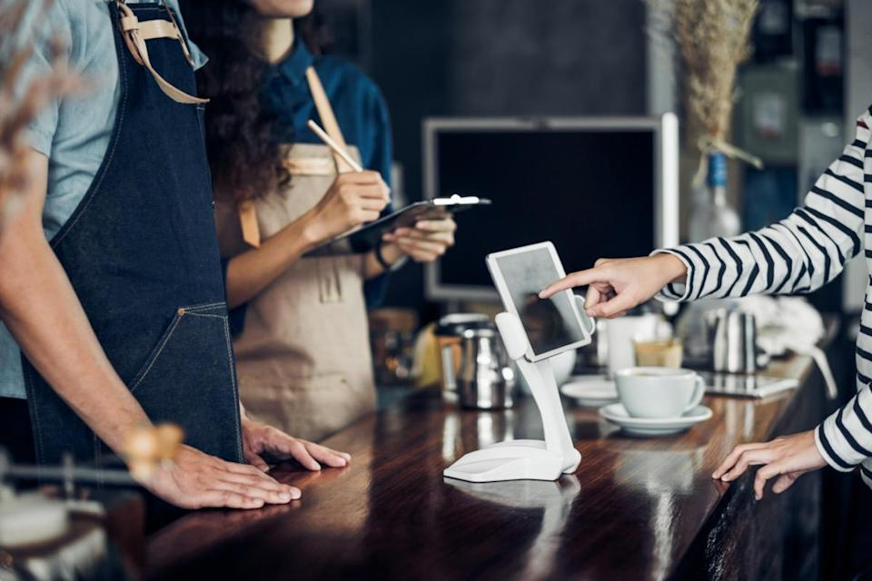customer self service order drink menu with tablet screen at cafe counter bar,seller coffee shop accept payment by mobile