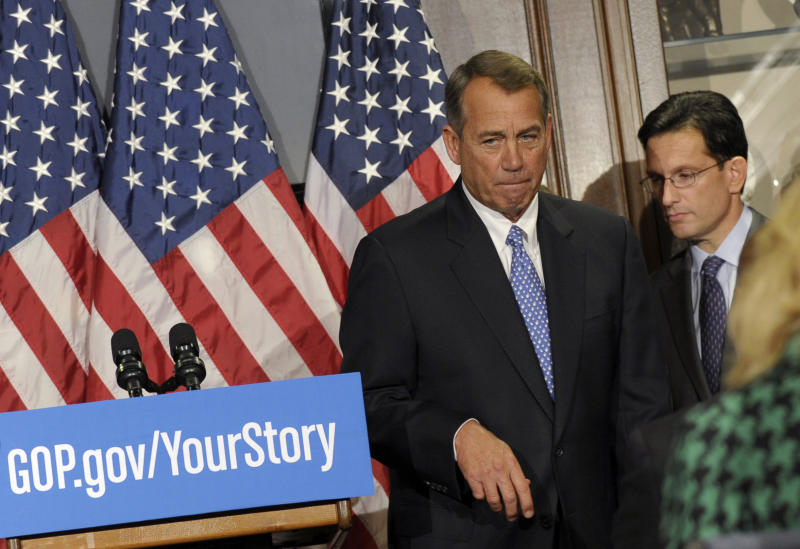 FILE - In this Oct. 23, 2013, file photo House Speaker John Boehner of Ohio, left, and House Majority Leader Eric Canton of Va., right, leave after a news conference on Capitol Hill in Washington. The ups and downs Boehner in 2013 dramatize the difficulties of managing a narrow Republican majority in the House. Some associates and observers say the low point of Boehner's year was almost a year ago, Jan. 3, 2013, the first day of the 113th Congress. With the Ohio Republican's family watching from the House gallery, a dozen defiant GOP lawmakers refused to back his bid to be re-elected speaker. The mini-rebellion fell short, but it delivered an embarrassing rebuke from conservatives. (AP Photo/Susan Walsh, File)