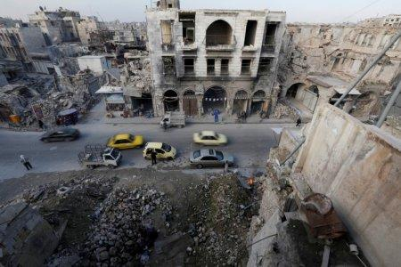 People and cars are seen in old town in Aleppo, Syria February 8, 2018. REUTERS/Omar Sanadiki