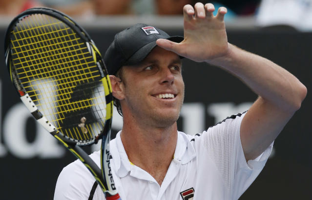 Sam Querrey of the U.S. celebrates, winning over Ernests Gulbis of Latvia during their second round match at the Australian Open tennis championship in Melbourne, Australia, Wednesday, Jan. 15, 2014.(AP Photo/Eugene Hoshiko)