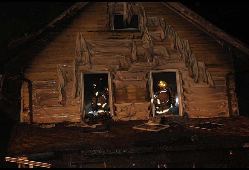 In thIs photo released by the Erie Fire department, firefighters work to put out a house fire in Erie, Pennsylvania early in the morning on August 11, 2019. - Five children died, and a mother that was injured was flown to a Pittsburgh hospital after an early morning fire in West Erie. (Photo by Scooter Blakely / AFP) / RESTRICTED TO EDITORIAL USE - MANDATORY CREDIT