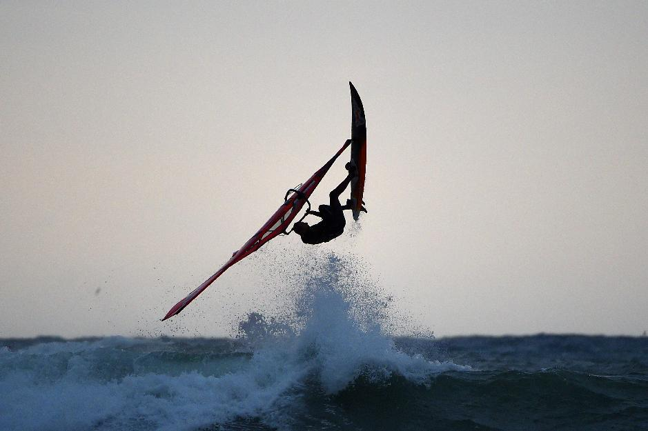 A windsurfer rides on the northern coast of Italy in Aurelia (western Genova) on November 4, 2014 in Andora.
