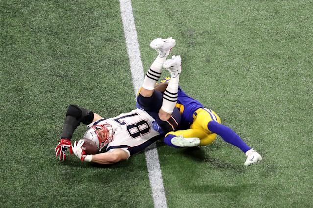 <p>Cory Littleton #58 of the Los Angeles Rams tackles Rob Gronkowski #87 of the New England Patriots in the second quarter during Super Bowl LIII at Mercedes-Benz Stadium on February 03, 2019 in Atlanta, Georgia. (Photo by Rob Carr/Getty Images) </p>