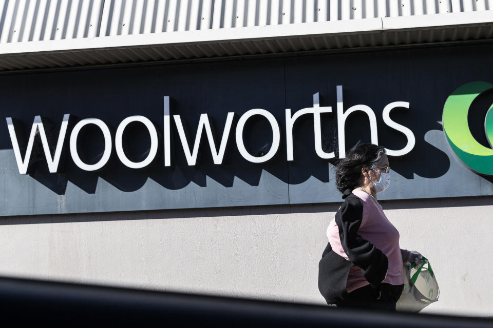 SYDNEY, AUSTRALIA - AUGUST 17: A woman in a surgical mask walks past the entrance to the Woolworths Metro supermarket in North Strathfield on August 17, 2020 in Sydney, Australia. New South Wales remains on high alert as new COVID-19 cases continue to be diagnosed. Customers of the Supermarket are being urged to watch for symptoms after a person who has tested positive for COVID-19 case visited the store over the weekend. The state recorded seven new cases of COVID-19 in the last 24 hours with six locally-acquired and one in hotel quarantine. (Photo by Brook Mitchell/Getty Images)