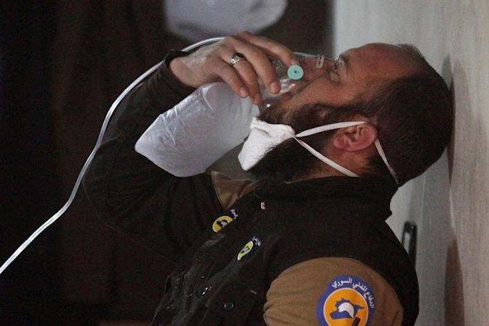 <p>A civil defense member breathes through an oxygen mask, after what rescue workers described as a suspected gas attack in the town of Khan Sheikhoun in rebel-held Idlib, Syria, April 4, 2017. (Ammar Abdullah/Reuters) </p>