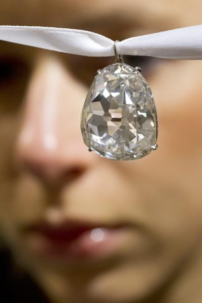 FILE - In this May 2, 2012 file photo an employee shows the Beau Sancy diamond, 34.98 carat, at Sotheby's auction house in Zurich, Switzerland. Marie de Medici wore it at her coronation as Queen Consort of Henry IV in 1610, and now the Beau Sancy diamond is a lavish accessory owned by an anonymous bidder who paid US $9.7 million (7.6 million euro) for it at Sotheby's auction in Geneva Tuesday May 15, 2012. The spring auction season for jewelry and watches is upon Geneva, where elegant lakefront hotels fill with well-heeled buyers and bidders in a scene far removed from the debate over European austerity. (AP Photo/Keystone, Alessandro Della Bella, File)