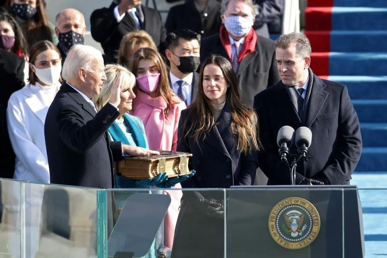 Joe Biden, seen here being sworn in as the 46th president of the United States, received seven million more votes than Donald Trump and won the Electoral College by 306 to 232 (AFP/Rob Carr)