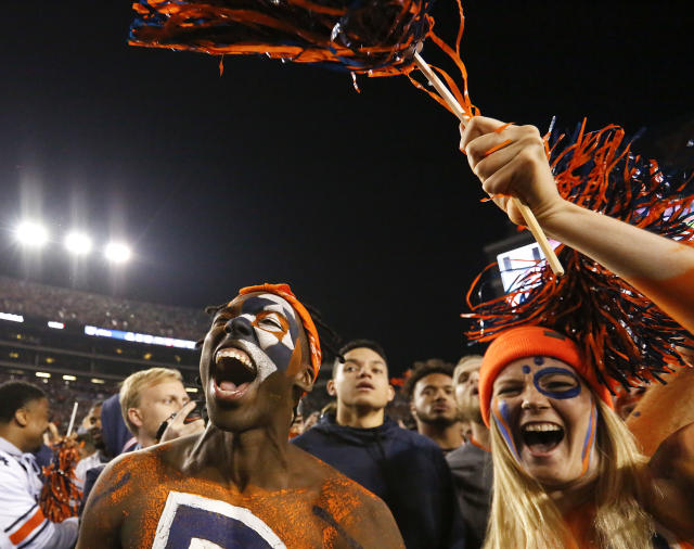 Auburn fans were delighted enough to rush their home field after the Tigers defeated rival Alabama 26-14 in the Iron Bowl. (AP)
