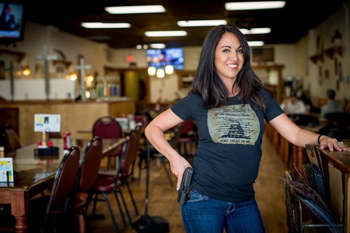 Owner Lauren Boebert poses for a portrait at Shooters Grill in Rifle, Colorado on April 24, 2018. - Lauren Boebert opened Shooters Grill in 2013 with her husband Jason in the small town of Rifle, Colorado, the only city in the United States named after a gun according to them. (Emily Kask/AFP via Getty Images)