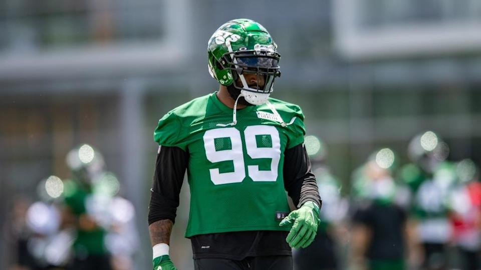Vinny Curry in bright green Jets practice Jersey