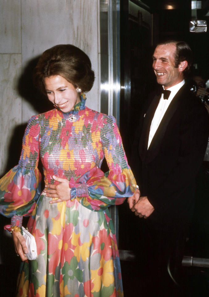 Princess Anne and her then fiancé Captain Mark Phillips, at the London premiere of the film 'Jesus Christ Superstar' in 1973, shortly after her 23rd birthday. Anne opted for a stunning floral dress with big sleeves and a high neckline. (AFP via Getty Images)