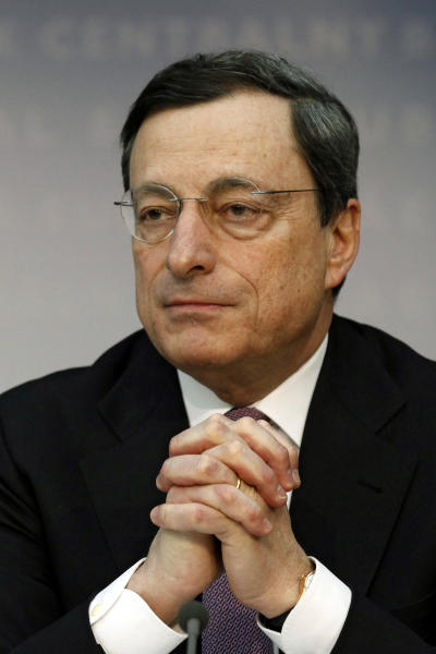 "President of the European Central Bank Mario Draghi attends a news conference, Thursday, March 8, 2012. The European Central Bank left its key interest rate unchanged Thursday at a record low of 1 percent, holding off on further measures to boost the shaky economy in the 17 countries that use the euro. Draghi said the eurozone economy is showing ""signs of stabilization"" and dropped the word ""tentative"" from last month's assessment of the steadying economy, making his outlook slightly less pessimistic. (AP Photo/dapd, Mario Vedder)"