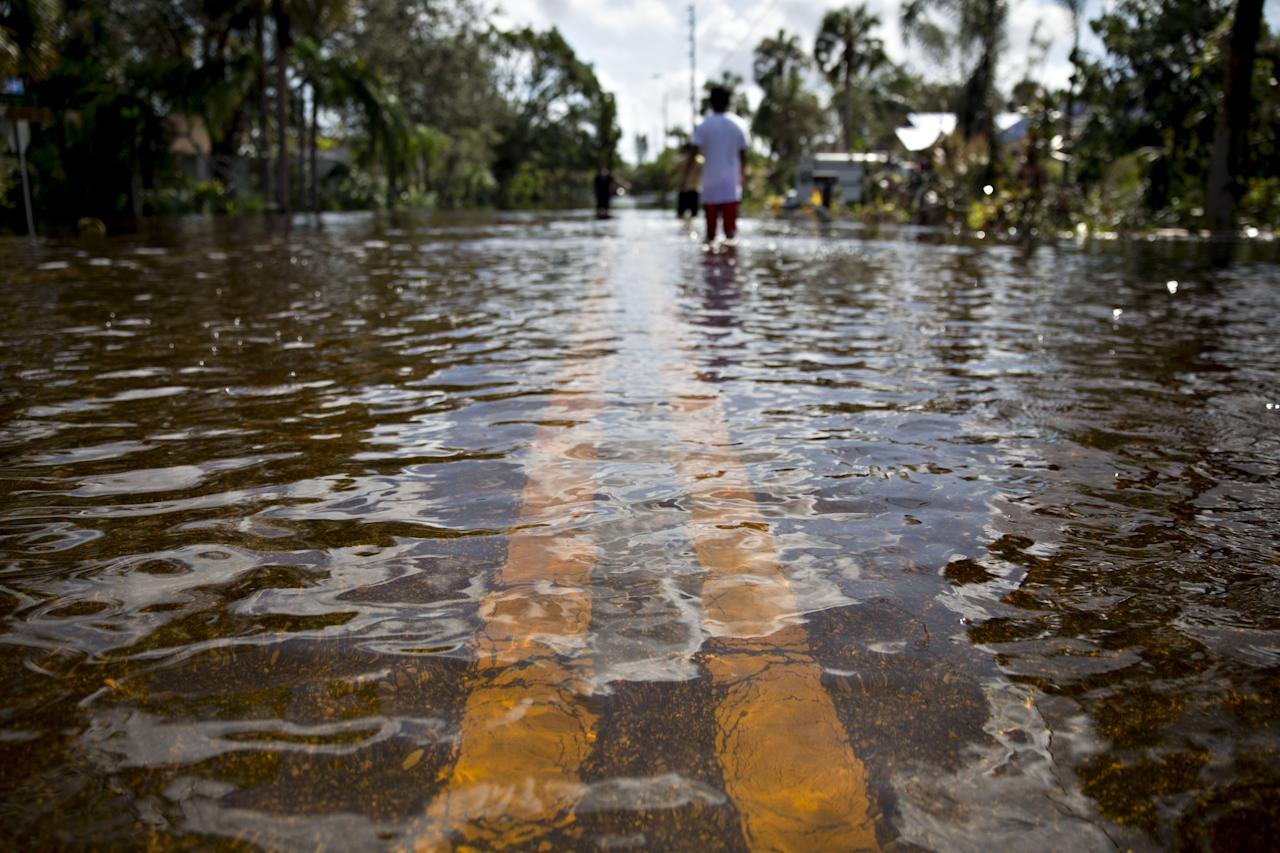 <p>Water covers a residential street in Bonita Springs, Florida, U.S., on Sept. 12, 2017. Hurricane Irma smashed into Southern Florida as a Category 4 storm, driving a wall of water and violent winds ashore and marking the first time since 1964 the U.S. was hit by back-to-back major hurricanes. Photographer: Daniel Acker/Bloomberg via Getty Images </p>