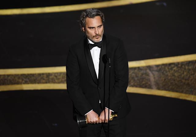 """Joaquin Phoenix accepts the Actor In A Leading Role award for """"Joker"""" onstage during the 92nd Annual Academy Awards at Dolby Theatre on February 09, 2020 in Hollywood, California. (Photo by Kevin Winter/Getty Images)"""