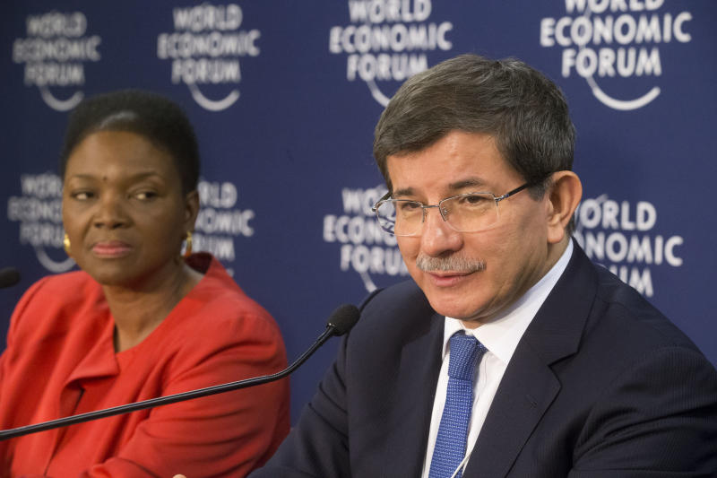 Turkish Foreign Minister Ahmet Davutoglu, center, speaks to the media as United Nation Under-Secretary-General for Humanitarian Affairs and Emergency Relief Coordinator, British Valerie Amos, left, sits next to him during a press conference on Syria at the 43rd Annual Meeting of the World Economic Forum, WEF, in Davos, Switzerland, Wednesday, Jan. 23, 2013. (AP Photo/Michel Euler)