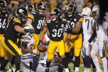 Dec 2, 2018; Pittsburgh, PA, USA; Pittsburgh Steelers running back James Conner (30) scores a first quarter touchdown against the San Diego Chargers at Heinz Field. Philip G. Pavely-USA TODAY Sports/File Photo