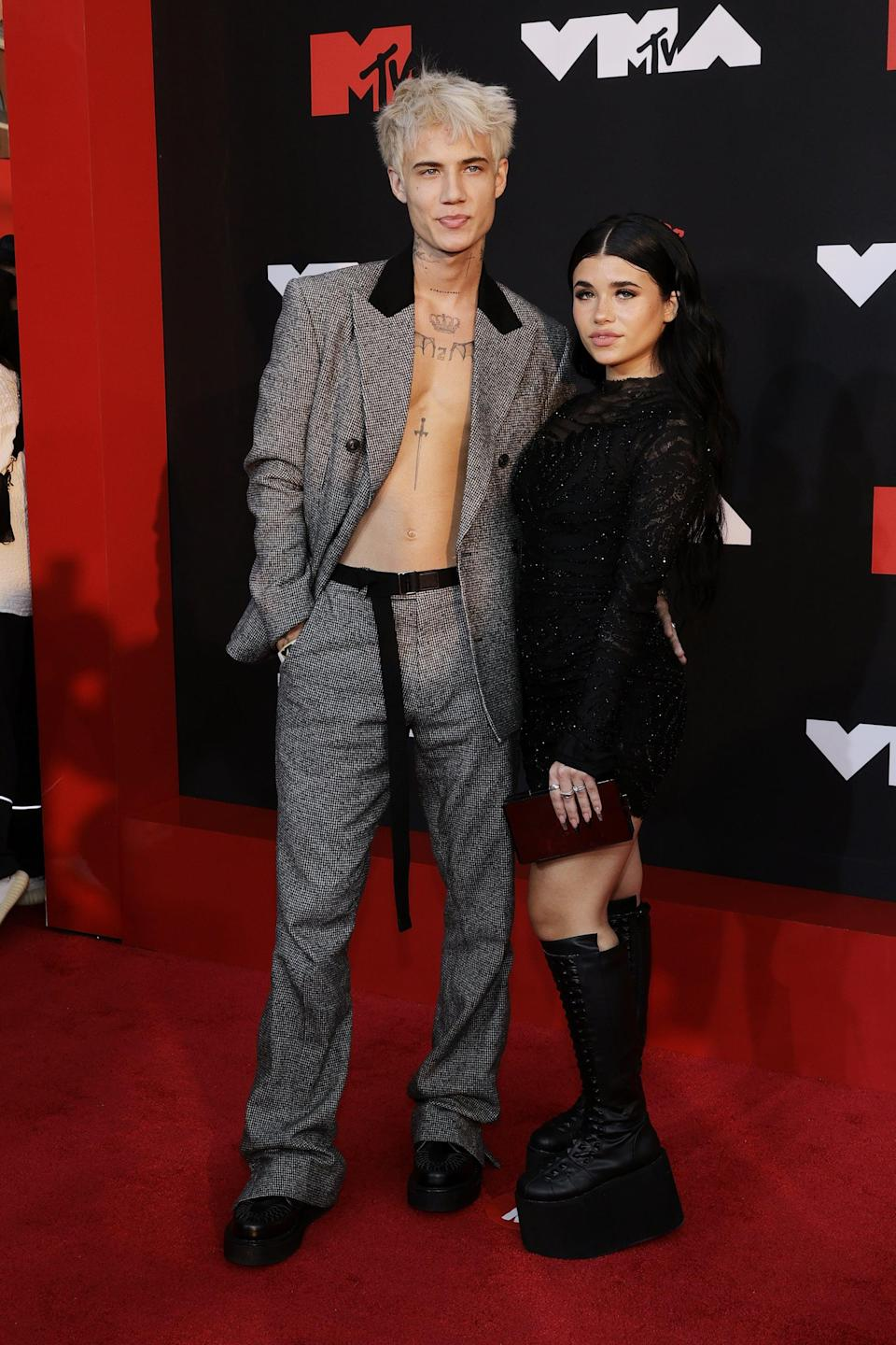 <p>JXDN is wearing an Amiri suit with George Cox shoes.</p>