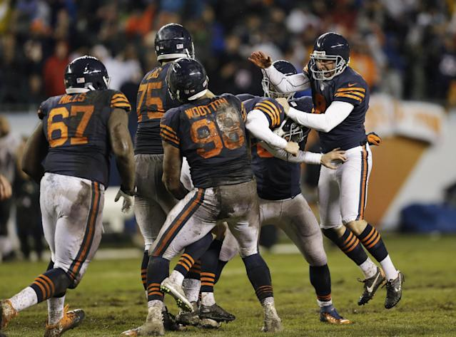 Chicago Bears players celebrate after kicker Robbie Gould booted the game-winning field goal in overtime to beat the Baltimore Ravens 23-20 in an NFL football game against the Baltimore Ravens, Sunday, Nov. 17, 2013, in Chicago. (AP Photo/Nam Y. Huh)
