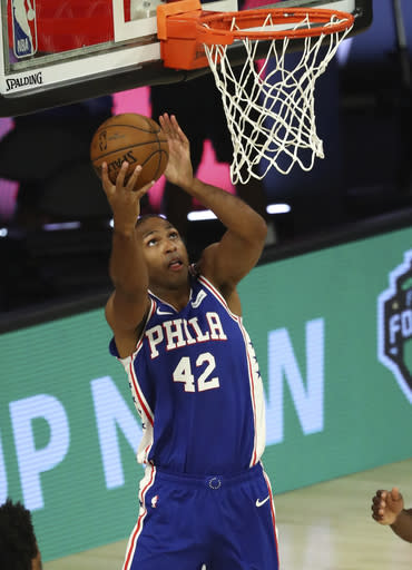 Philadelphia 76ers forward Al Horford (42) shoots during the third quarter against the Boston Celtics in Game 4 of an NBA basketball first-round playoff series, Sunday, Aug. 23, 2020, in Lake Buena Vista, Fla. (Kim Klement/Pool Photo via AP)