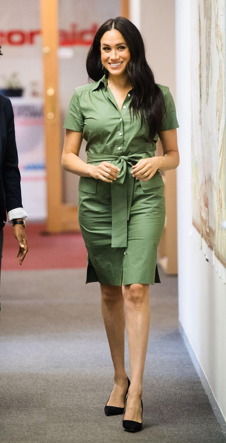 """<p>During her busy day in Johannesburg, the Duchess of Sussex <a href=""""https://www.townandcountrymag.com/society/tradition/a29319416/meghan-markle-action-aid-hug-south-africa-photos/"""" rel=""""nofollow noopener"""" target=""""_blank"""" data-ylk=""""slk:also visited ActionAid,"""" class=""""link rapid-noclick-resp"""">also visited ActionAid,</a> where she joined a discussion about gender-based violence. Meghan wore a green dress by Room 502 with a pair of black heels.</p>"""