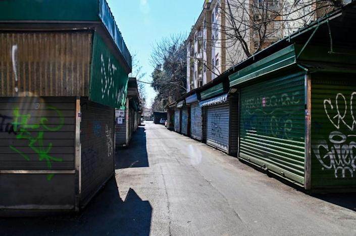 Shuttered market stalls in Rome's Monteverde Vecchio district on Wednesday (AFP Photo/ANDREAS SOLARO)