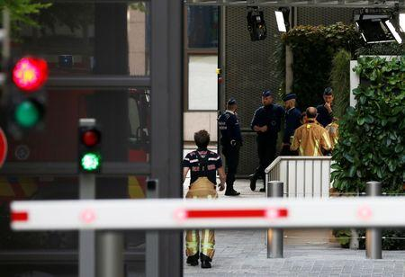 Emergency services personnel are seen at the entrance of the European Union Council building after noxious gases were found in its kitchens in Brussels, Belgium October 13, 2017. REUTERS/Francois Lenoir