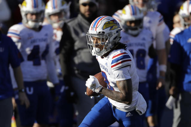 Kansas wide receiver Kwamie Lassiter II (8) runs the ball during the first half of an NCAA college football game against Baylor, Saturday, Nov. 30, 2019, in Lawrence, Kan. (AP Photo/Charlie Riedel)