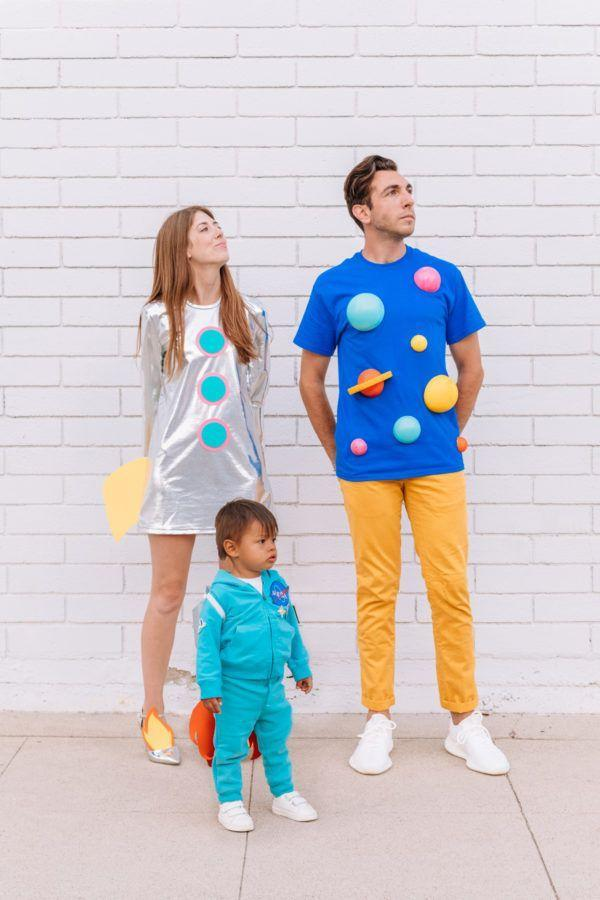 """<p>We're sure you'd agree that this costume idea is <em>out of this world.</em> You can even let the whole family in on the fun with a teeny-tiny NASA costume for toddlers or kids!</p><p><strong>Get the tutorial at <a href=""""https://studiodiy.com/2018/10/05/22-diy-group-couple-halloween-costumes/"""" rel=""""nofollow noopener"""" target=""""_blank"""" data-ylk=""""slk:Studio DIY"""" class=""""link rapid-noclick-resp"""">Studio DIY</a>. </strong></p><p><a class=""""link rapid-noclick-resp"""" href=""""https://www.amazon.com/Gildan-Ultra-Cotton-T-Shirt-2-Pack/dp/B07612DJHD?tag=syn-yahoo-20&ascsubtag=%5Bartid%7C10050.g.4616%5Bsrc%7Cyahoo-us"""" rel=""""nofollow noopener"""" target=""""_blank"""" data-ylk=""""slk:SHOP BLUE T-SHIRTS"""">SHOP BLUE T-SHIRTS</a></p>"""