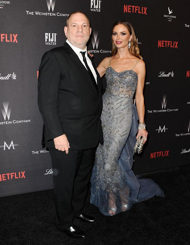 Harvey's wife Georgina is standing by him. Source: Getty