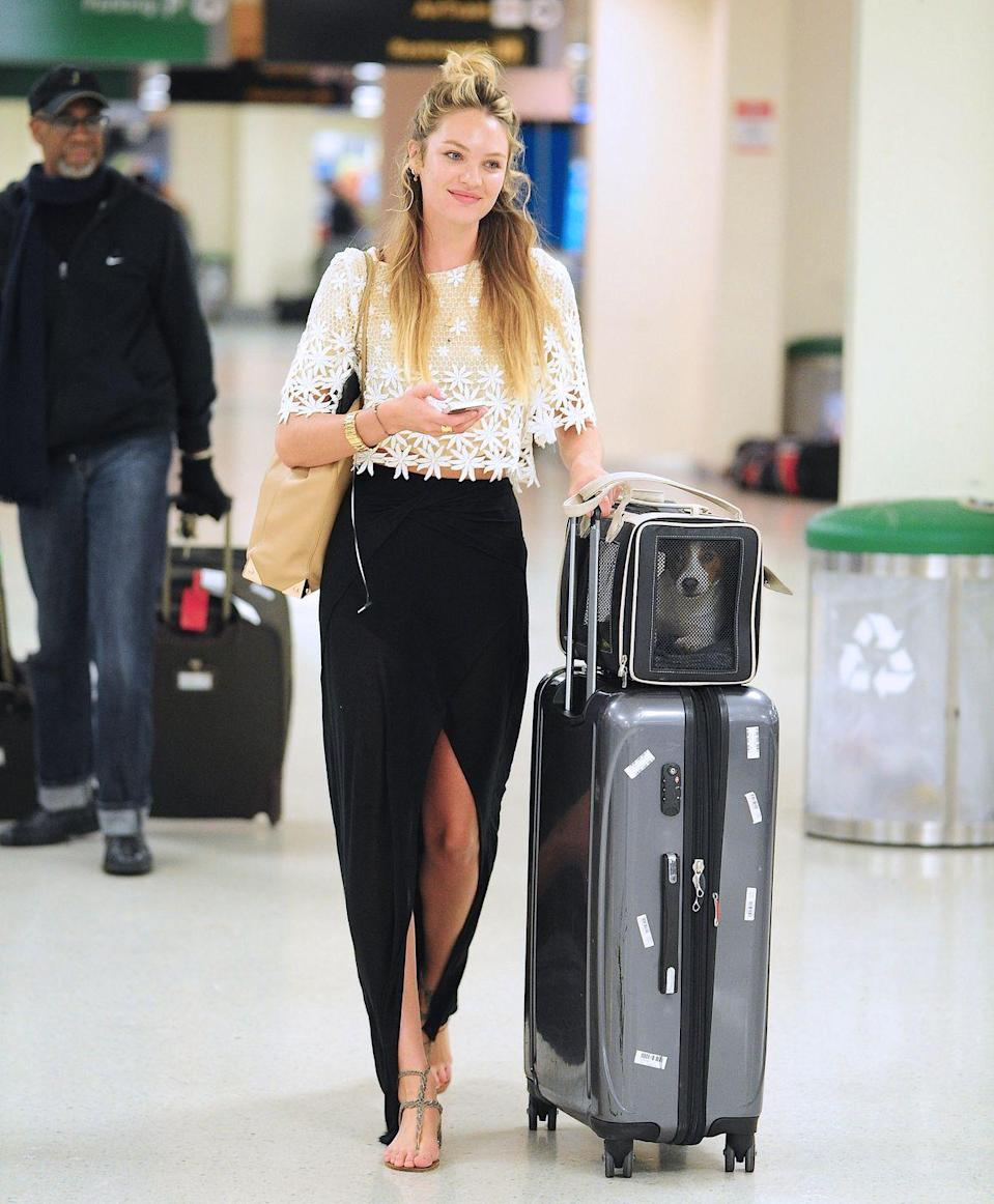 <p><strong>Candice Swanepoel, 2013:</strong> Candice appears to be stepping on the hem of her maxi skirt, but that doesn't stop her from powering through her airport walk like the supermodel that she is.</p>