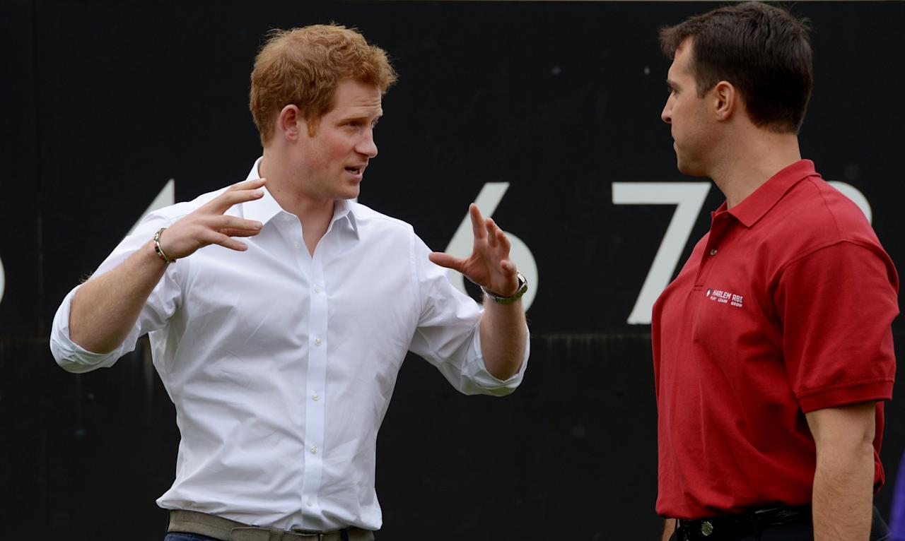 NEW YORK, NY - MAY 14:  HRH Prince Harry (L) talks with baseball player Mark Texeria of the New York Yankees while participating in a baseball clinic during the launch of a new partnership between the Royal Foundation of the Duke and Duchess of Cambridge and Harlem RBI, a local community organization May 14, 2013 in the Harlem neighborhood of New York City. HRH will be undertaking engagements on behalf of charities with which the Prince is closely associated on behalf also of HM Government, with a central theme of supporting injured service personnel from the UK and US forces.  (Photo by Justin Lane - Pool/Getty Images)