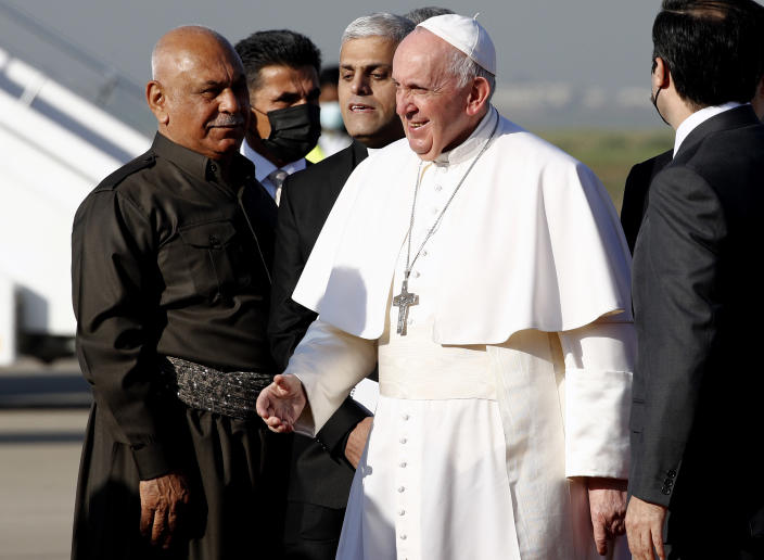 Pope Francis arrives at Irbil airport, Iraq, Sunday, March 7, 2021. Pope Francis arrived in northern Iraq on Sunday, where he planned to pray in the ruins of churches damaged or destroyed by Islamic State extremists and celebrate an open-air Mass on the last day of the first-ever papal visit to the country. (AP Photo/Hadi Mizban)