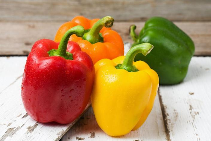 """<p>No matter what color bell pepper you choose, you'll be loading up on vitamins, minerals, and fiber, but very few calories. They're also versatile—<a href=""""https://www.prevention.com/food-nutrition/recipes/a20502475/parsnip-pepper-and-onion-hash/"""" rel=""""nofollow noopener"""" target=""""_blank"""" data-ylk=""""slk:sauté"""" class=""""link rapid-noclick-resp"""">sauté</a> them, turn them into a <a href=""""https://www.prevention.com/food-nutrition/recipes/a20525967/creole-pea-and-pepper-soup/"""" rel=""""nofollow noopener"""" target=""""_blank"""" data-ylk=""""slk:soup"""" class=""""link rapid-noclick-resp"""">soup</a>, <a href=""""https://www.prevention.com/food-nutrition/recipes/a20482693/rice-and-turkey-stuffed-peppers/"""" rel=""""nofollow noopener"""" target=""""_blank"""" data-ylk=""""slk:stuff"""" class=""""link rapid-noclick-resp"""">stuff</a> them, <a href=""""https://www.prevention.com/food-nutrition/recipes/a20482529/roasted-red-pepper-chicken/"""" rel=""""nofollow noopener"""" target=""""_blank"""" data-ylk=""""slk:roast"""" class=""""link rapid-noclick-resp"""">roast</a> them, or eat them raw.</p>"""