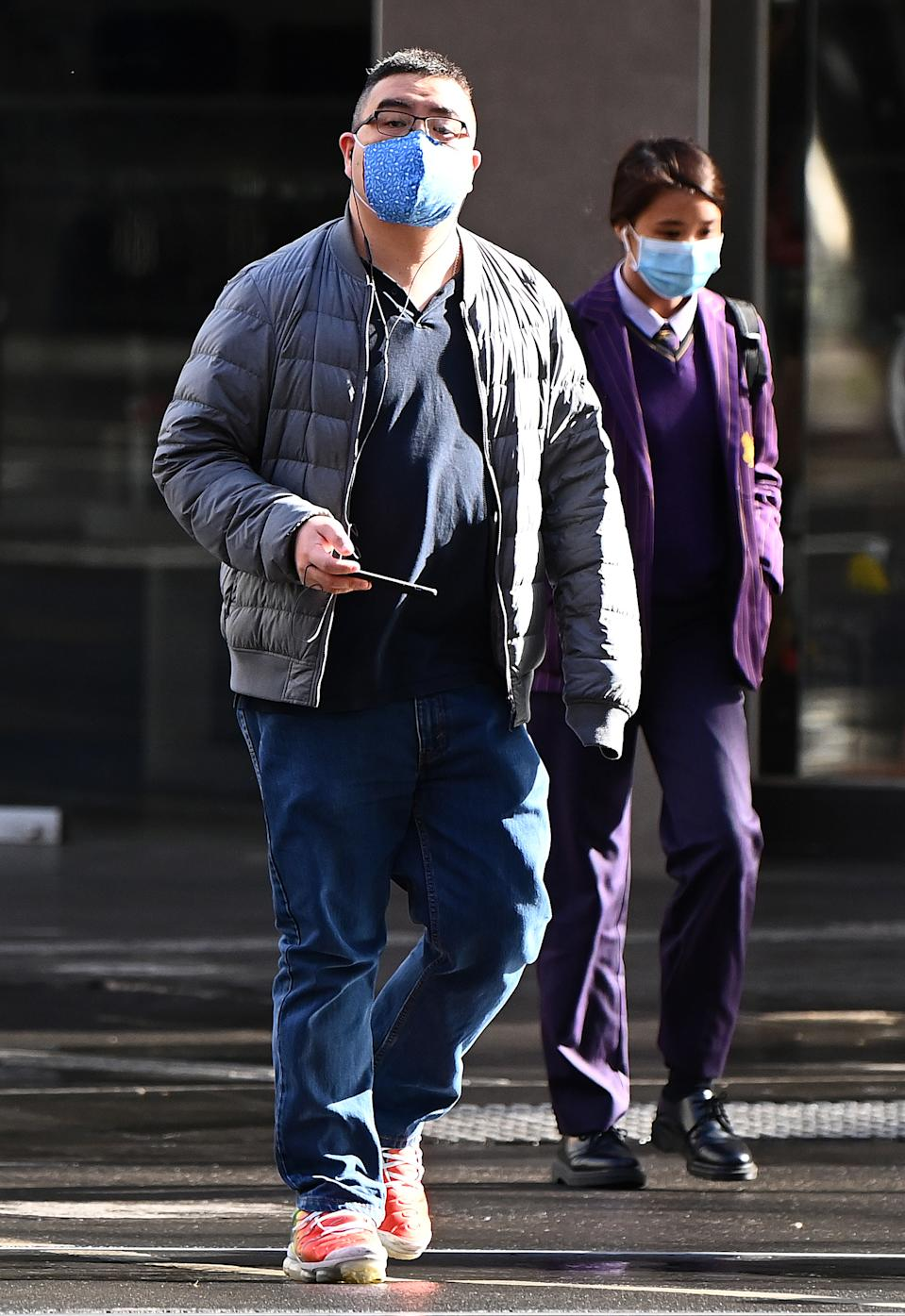 Photo shows people in Melbourne wearing face masks.