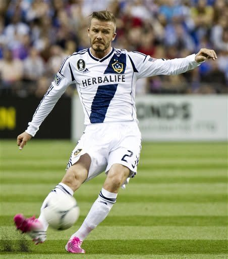 LA Galaxy's David Beckham kicks the ball as they face the Montreal Impact during the first half of an MLS soccer match in Montreal, Saturday, May 12, 2012. (AP Photo/The Canadian Press, Paul Chiasson)