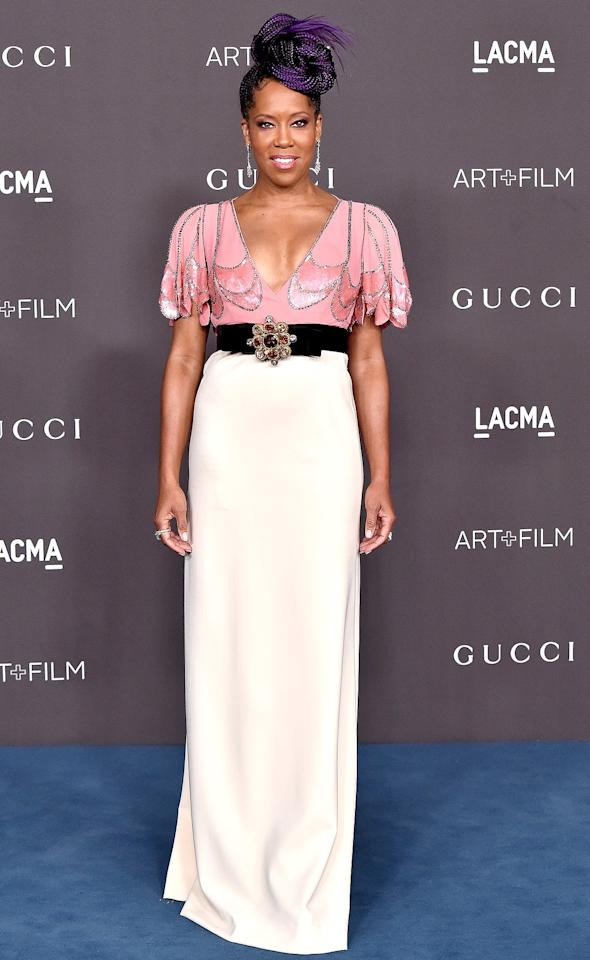 wears a Gucci short-sleeved gown with metallic trim and an embellished belt at the 2019 LACMA Art + Film Gala in L.A.