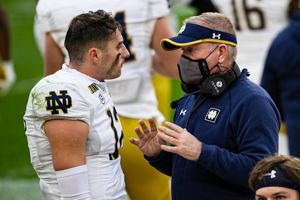 Notre Dame Fighting Irish QB Ian Book (12) talks with coach Brian Kelly on the sideline during a game against Pittsburgh on Oct. 24, 2020. (Mark Alberti/Icon Sportswire via Getty Images)