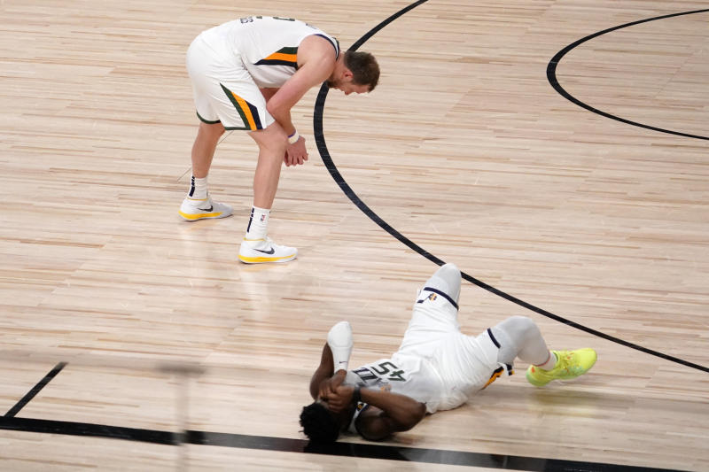The Jazz's Joe Ingles (2) and Donovan Mitchell absorb the moment after losing to the Nuggets in Game 7 Tuesday night. (AP Photo/Mark J. Terrill)